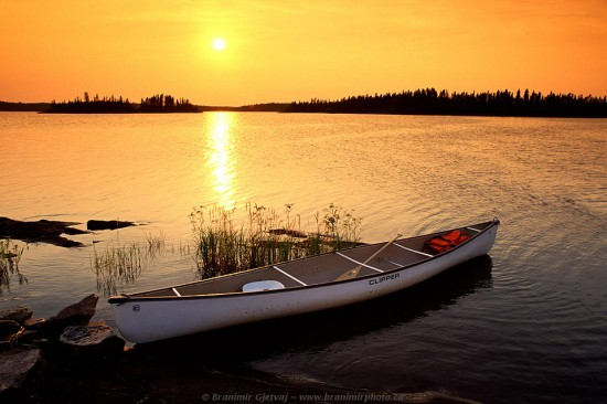 Canoe on Churchill River at sunset, near Stanley Mission, Saskatchewan
