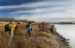 Photographers on the shore of South Saskatchewan River, Cranberry Flats