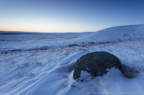 Twilight decends over snow-covered prairie. Grasslands National Park.
