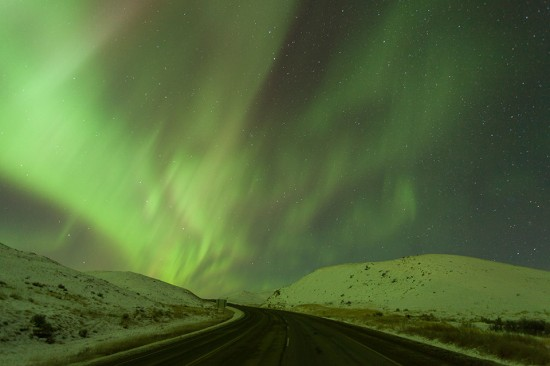 Display of Northern lights (Aurora Borealis) over Highway #4 at Saskatchewan Landing Provincial Park, Saskatchewan