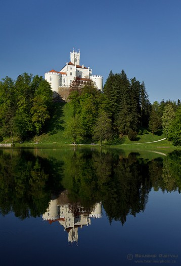 A picture-perfect Trakoscan castle (13th century) reflecting in calm surface of a lake, Croatia