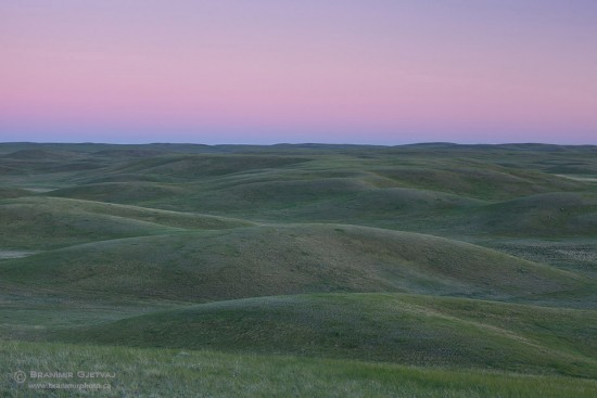 Sunset over rolling prairie hills at Old Man on His Back Prairie and Heritage Conservation Area, Claydon