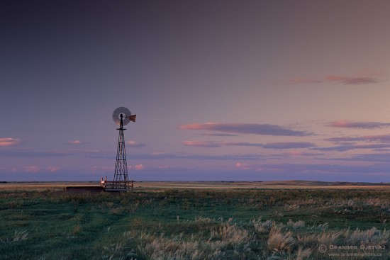 Prairie windmill at sunset. Great Sand Hills, Saskatchewan