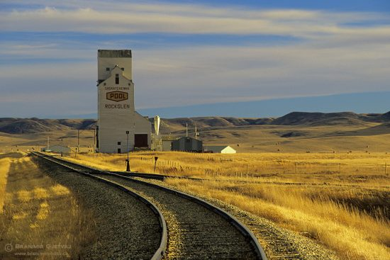 Rockglen grain elevator and train tracks at sunset, Saskatchewan
